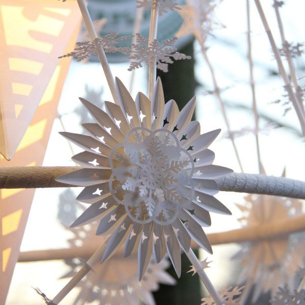 all-white paper ornament on a handmade pajaki