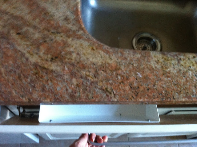 kitchen sink tip-out tray