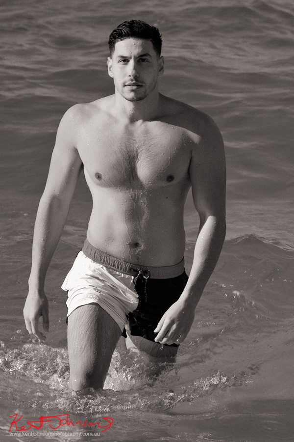 Gaz walking out of the sea. Male modelling portfolio shot on Location in Sydney Australia by Kent Johnson.