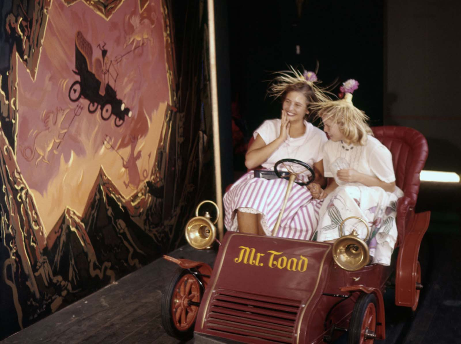 Visitors take a ride on Mr. Toad's Wild Ride at Disneyland on July 17, 1955.