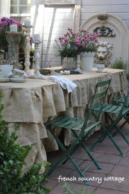 Ruffled Burlap tablecloth with flowers and french bistro chairs