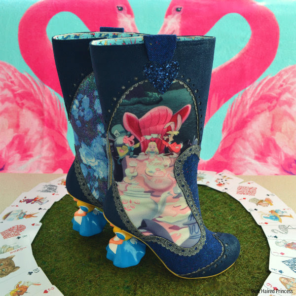 right boot with left boot in background showing Alice tea party image on side