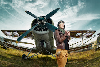 A woman pilot dressed in the style of Amelia Earhart