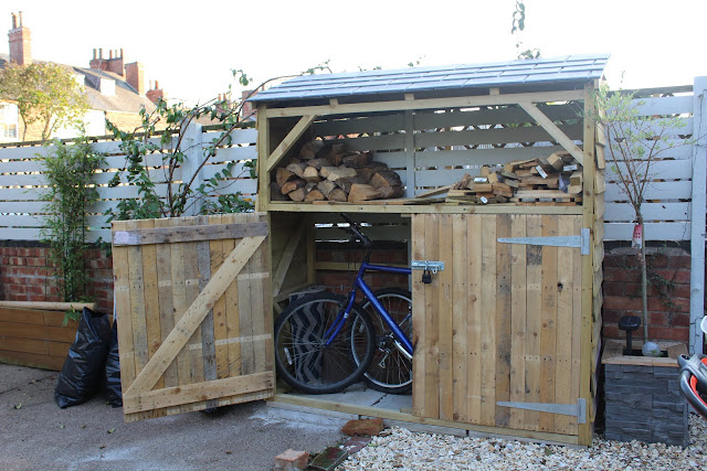 DIY bike shed with log store