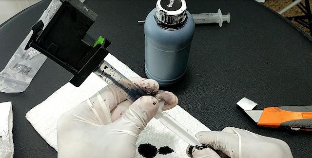 extraer 1 ml de tinta del cartucho luego de rellenarlo