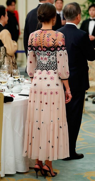 Queen Letizia wore Temperley London Eggshell floral embroidery tulle midi dress and Hugo Boss Dadoria beltedsheath dress