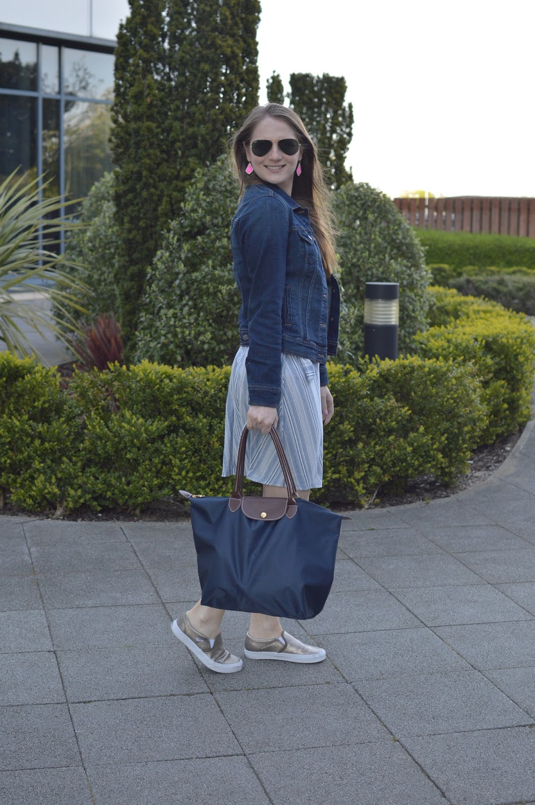 jean jacket over a dress | ways to style a denim jacket | spring outfit ideas | casual spring looks | dresses with sneakers | a memory of us | navy longchamp bag