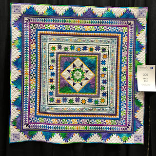 Quilt show example with cross stitched border, full view