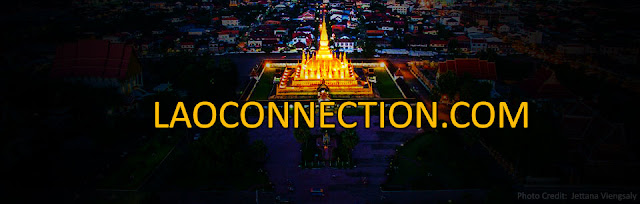 A Drone Aerial Photo of a Glowing Tat Luang
