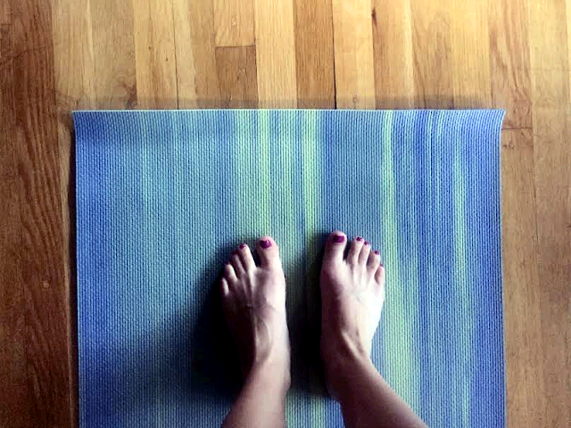 Hard wood floor with yoga mat. Photo taken standing on yoga mat with Painted Toed Feet.