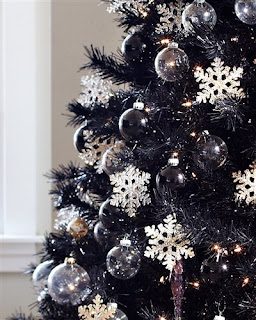 Close-up of a large Christmas tree with white and crystal decorations.