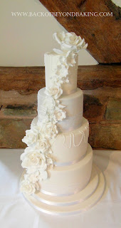 4 tier flower cascade wedding cake