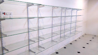 Wall Glass Rack Design for Shop,Home,Office & Business,glass rack design,home glass rack design,how to fix glass,office glass racks,wall racks,glass racks,images,best glass racks,hanger,glass rack for shop,counter design,wall design,office interior,shop interior,cloth shop,women shop,men shop,footwear shop,fibre glass,best design,modern,latest,kitchen glass,glass stand,glass frame,how to design