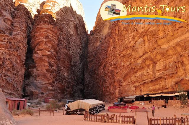 Mountains and Bedouin tents in wadi rum Jordan ~ Mantis Tour