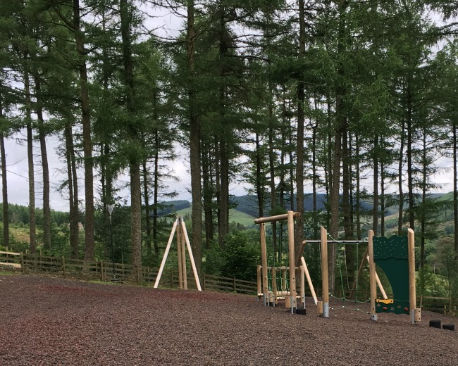 Garwnant-Visitor-Centre-A-Toddler-Explores-playground-with-views