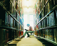 image of a student in a library, alone
