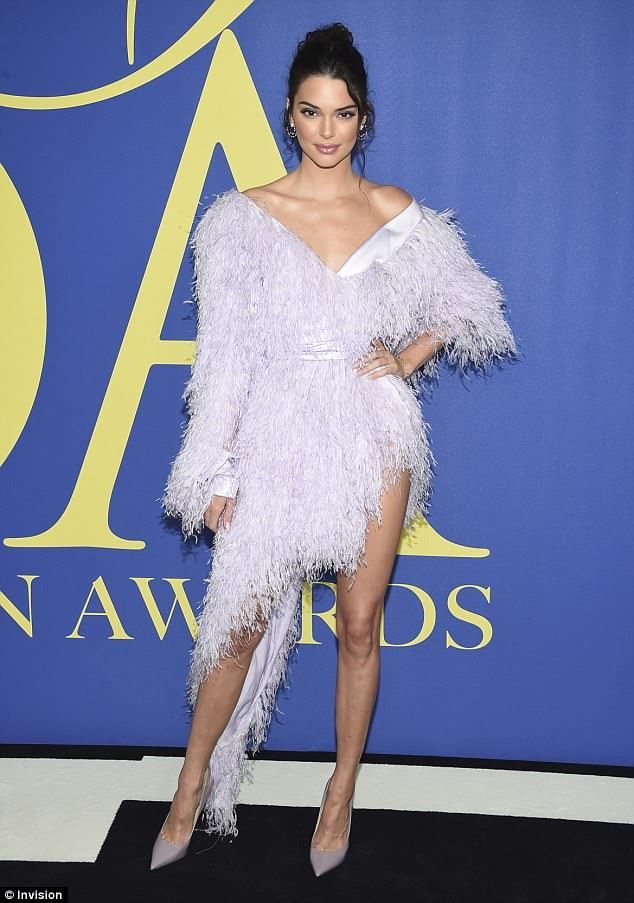Kendall Jenner flaunts her supermodel pins as she rocks pink feather couture for CFDA Fashion Awards