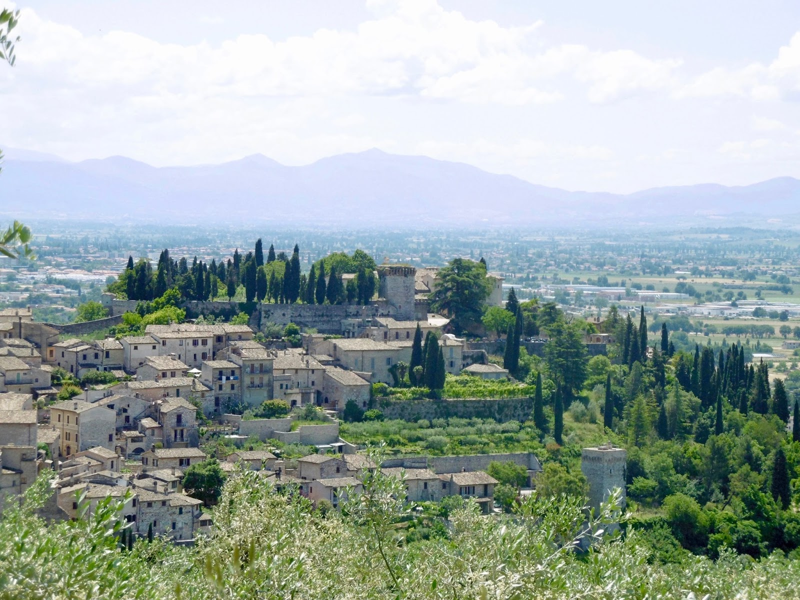 The view from the stunning mountain town of Spello in Italy showing the old buildings within the walled city