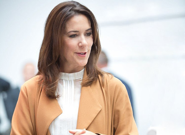 Crown Princess Mary wore Julie Fagerholt Heartmade Hemsley Dress, Sergio Rossi Snakeskin Suede Pumps, Carlend Copenhagen Vanessa Original Croco Clutch bag. Crown Princess Mary wore Fonnesbech Amaya Long Jacket