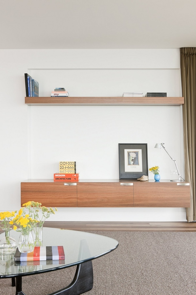 Wooden modern shelves on the wall