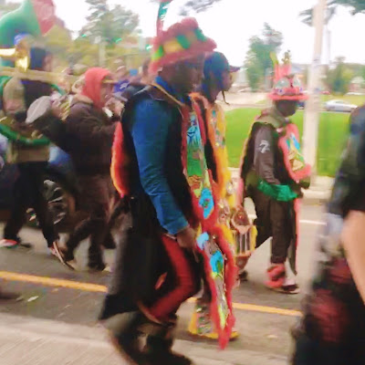 Parade Marchers dressed as Mardi Gras Indians in PRONK - the Honk Fest of Providence