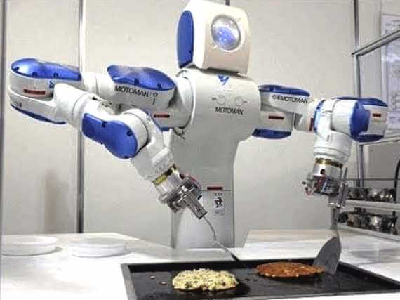 Motomon android robot cooks up a burger and hash browns