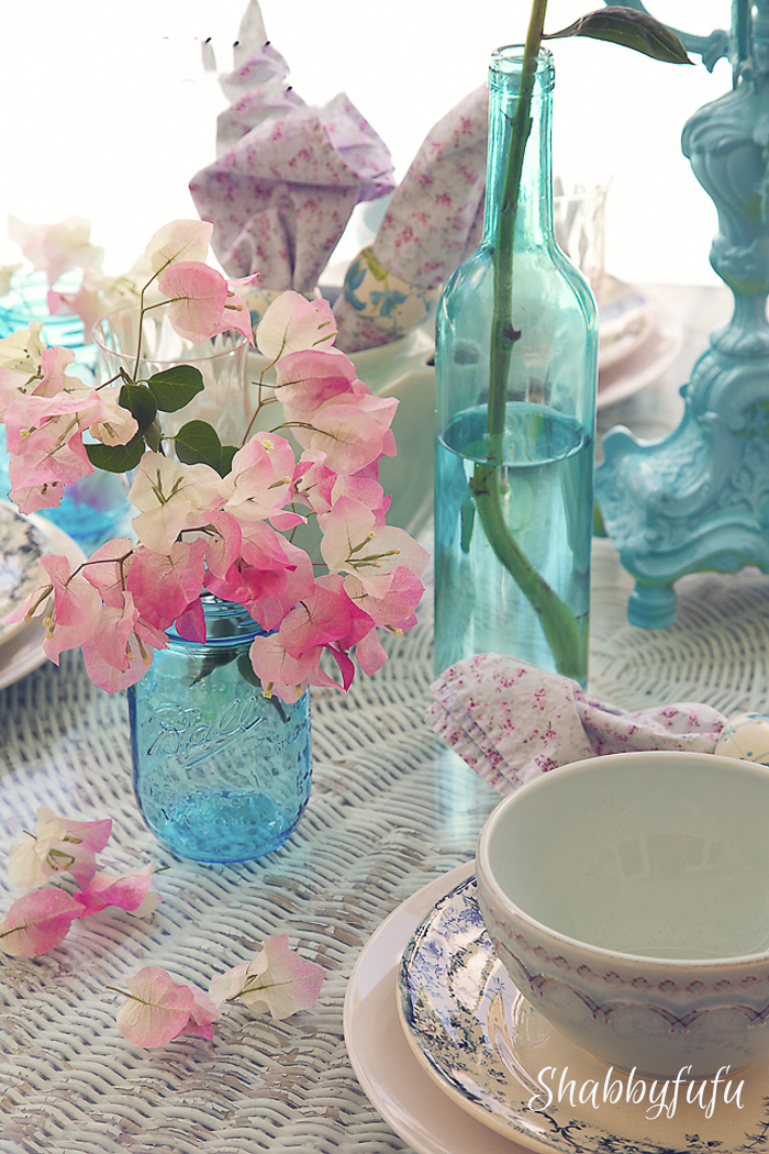 summer table with pink flowers and aqua dishes