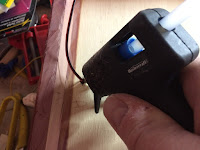 Secure the wires with hot glue - first by applying glue to the entry holes to anchor the wires