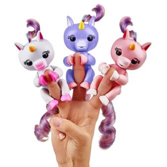 3 Fingerlings Baby Unicorn on one hand