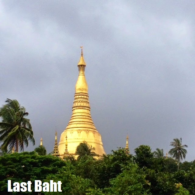 the golden spires of Shwedagon Pagoda rises over the jungle against a stormy sky, Yangon (Rangoon) Myanmar (Burma)