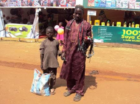 Photo: A Blind Man by the Name Lawal Hawking Phone Accessories in Jos, Instead Of Begging