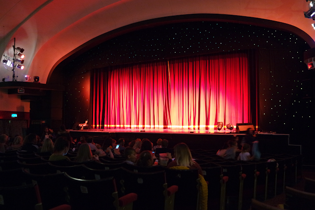 red curtains closed on stage in North Pier theatre