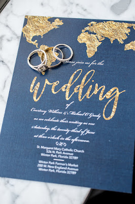 navy and gold world map wedding invitations