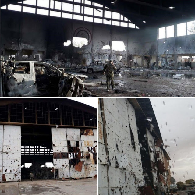 Image Attribute: Photos from the air base seem to show a Syrian soldier inspecting a large hangar-style building with heavy damage. / Source: Tasnim News Agency's Twitter handle.