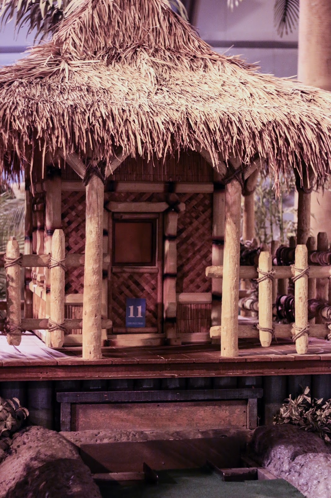 a fake tiki hut at hole 11 on the golf course