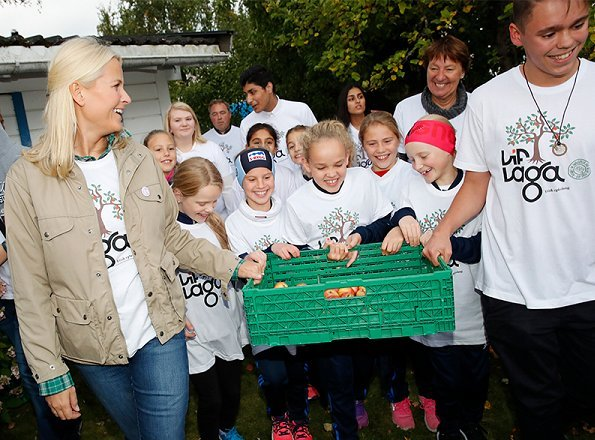 Crown Princess Mette-Marit of Norway visited a apple-picking project  'Lif Laga' at the Høybråten Sports Park in Oslo