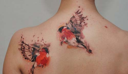 back watercolor bird tattoo sırt turuncu kuş dövmesi