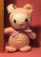 http://www.ravelry.com/patterns/library/tiny-amigurumi-kitty-in-jammies
