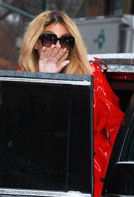 Wendy Williams steps out in bright red trench coat in New York (photos)