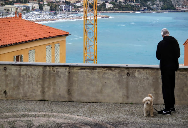 Things to see in Menton France - sea views, man with dog