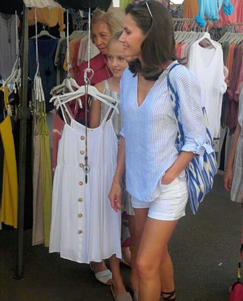 Crown Princess Leonor and Infanta Sofia wore a new linen blend striped jumpsuit by Mango and RIia Menorca Pau sandals