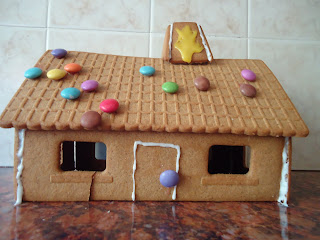 Our Excellent Gingerbread house that we are very proud of even though it looks a bit naff!