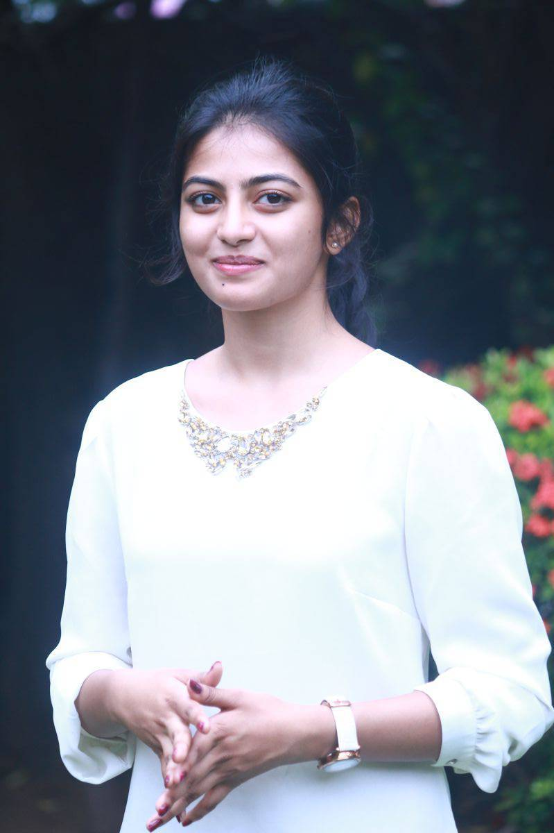 Actress Anandhi Latest Smiling Photos In White Top Blue Jeans