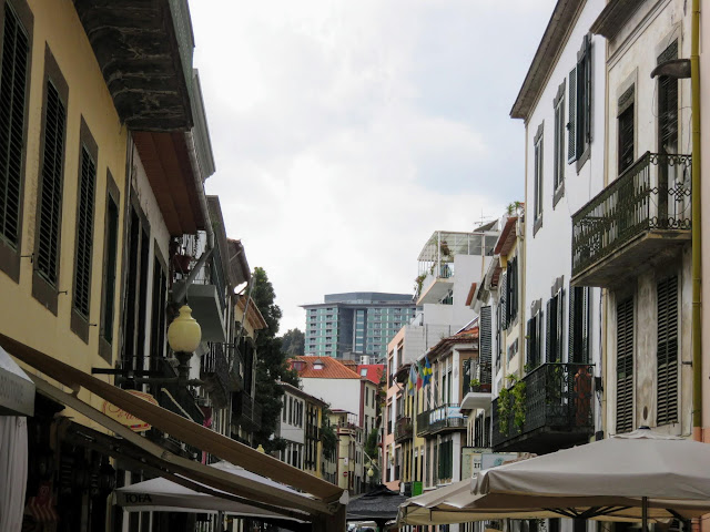 Pedestrian street lined with cafes in Funchal, Madeira