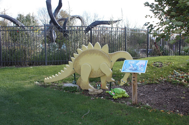 Whimsical dinosaur and frog delight on the story walk at Rotary Botanical Gardens in Janesville, Wisconsin