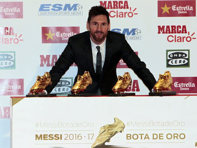 Messi with his four golden boot awards