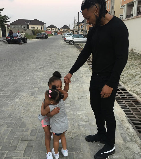 Aww! Proud dad Flavour watches his two daughters play