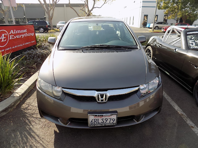 2011 Honda Civic with dented hood & bumper after repairs at Almost Everything Auto Body.
