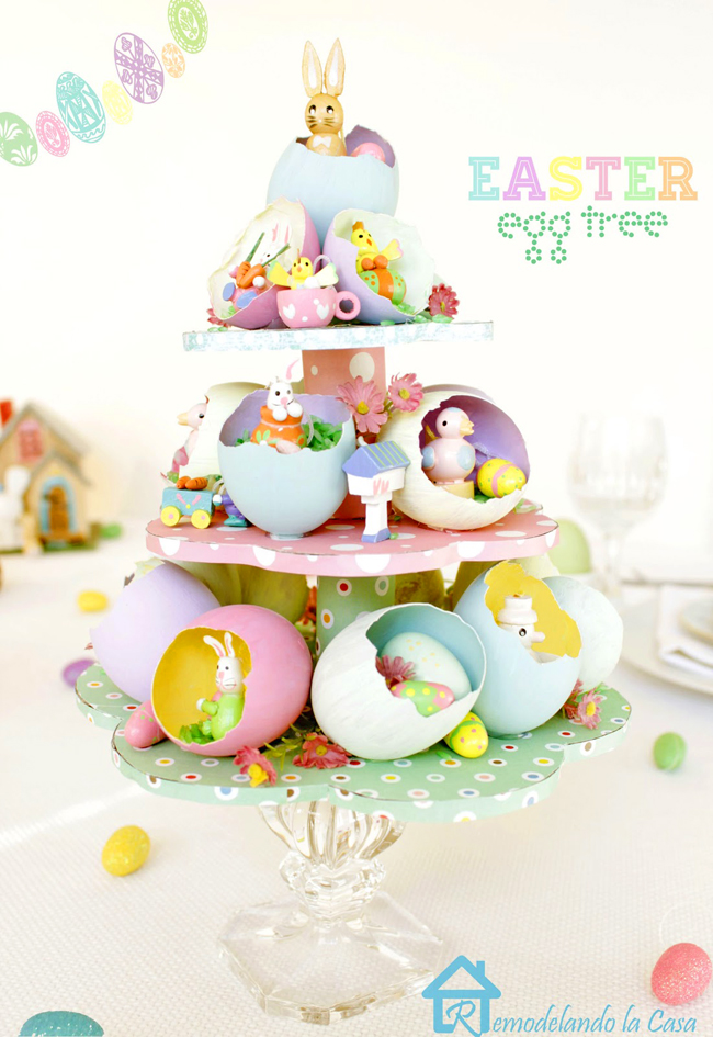 small bunnies and small figures are housed in egg shells to create an Easter Egg Tree centerpiece