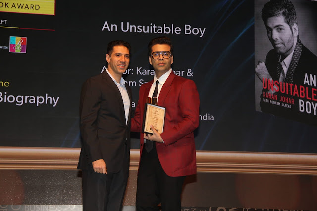 Karan Johar receiving the award for his book An Unsuitable Boy at Raymond Crossword Book Award 2018